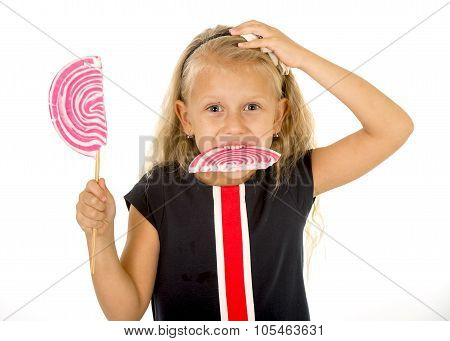 Beautiful Little Female Child With Sweet Blue Eyes And Long Blond Hair Eating Huge Lollipop Spiral C