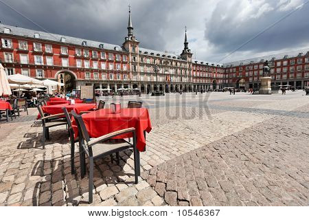 Cafe Tables With Red Tableclothes In Plaza Mayor.