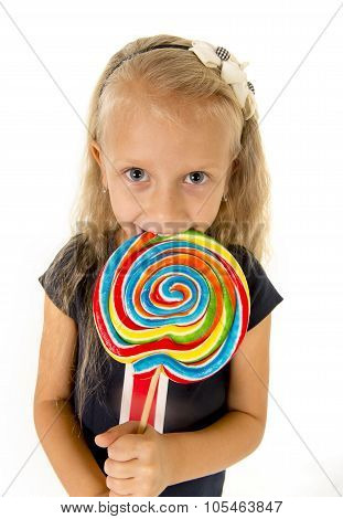 Beautiful Little Female Child With Sweet Blue Eyes Eating Huge Lollipop Spiral Candy Smiling Happy