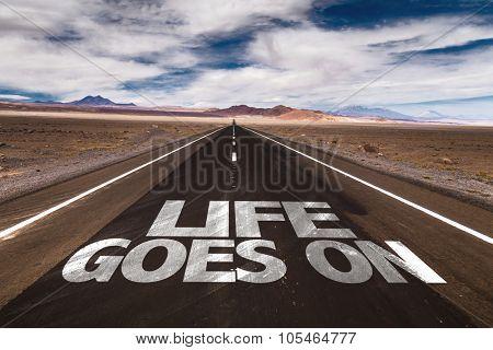 Life Goes On written on desert road