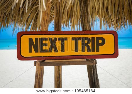 Next Trip sign with beach background