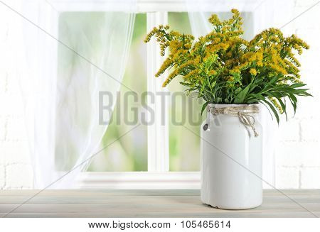 Beautiful mimosa flowers on light curtains background