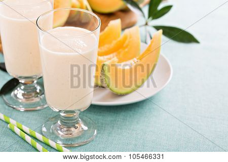 Healthy cantaloupe smoothie in a tall glass