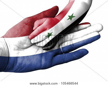 Adult Man Holding A Baby Hand With Netherlands And Syria Flags Overlaid. Isolated On White