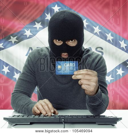 Dark-skinned Hacker With Usa States Flag On Background Holding Credit Card - Arkansas