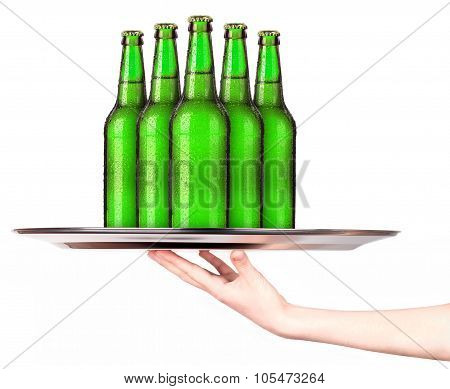 Waitress holding tray with bottles of beer isolated