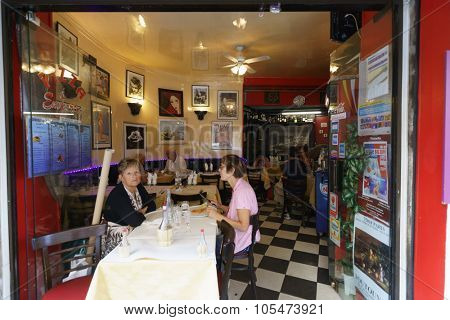PARIS - SEPTEMBER 10, 2014: customers of Parisian cafe. Parisian cafes serve as a center of social and culinary life in Paris