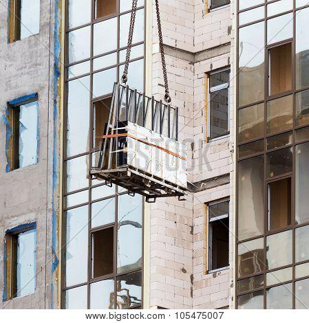 Glazed Windows Double-glazed Windows In The Construction Of High-rise Buildings, Raises A Crane
