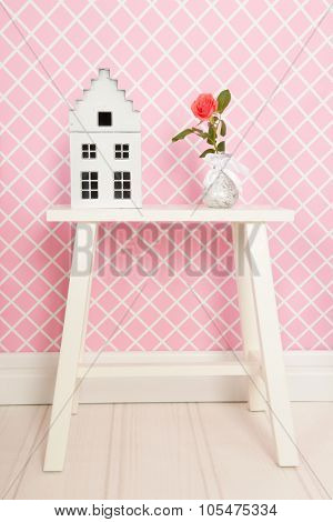 Single rose and decoration in pink interior