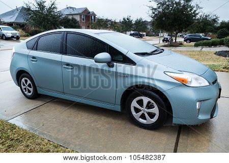 Pearland, Tx/usa - 01 24 2014: Toyota Prius Car Covered In Ice During Rare Ice Storm In Houston, Tx