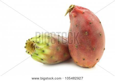 two fresh colorful cactus fruits on a white background