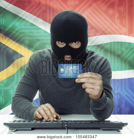 Dark-skinned Hacker With Flag On Background Holding Credit Card - South Africa