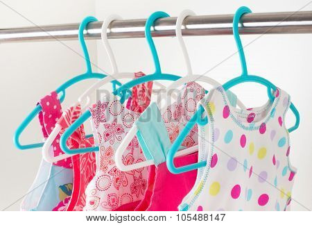 Row Of Little Girl Dresses Hanging On Coat Hanger