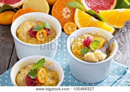 Citrus pudding in white ramekins
