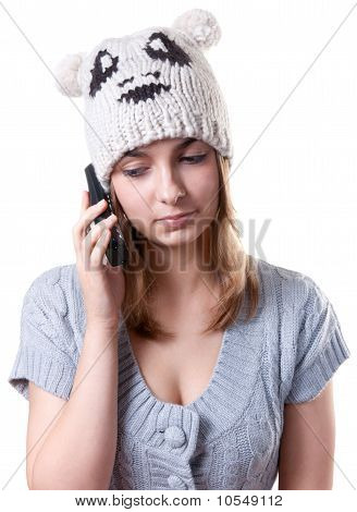 Beautiful Girl In Winter Hat With Telephone