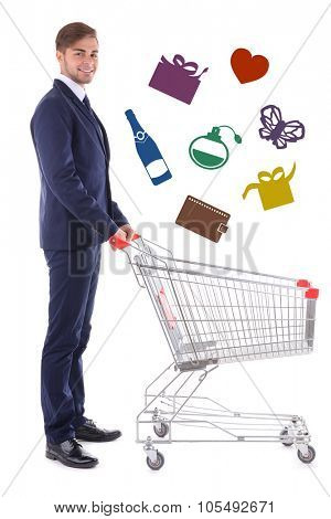 Young man pushing empty shopping cart with different icons, isolated on white
