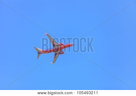 Airplane takes off on a blue sky