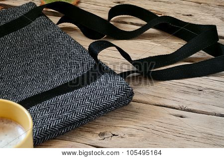 Female Gray Woolen Bag On A Wooden Table Closeup