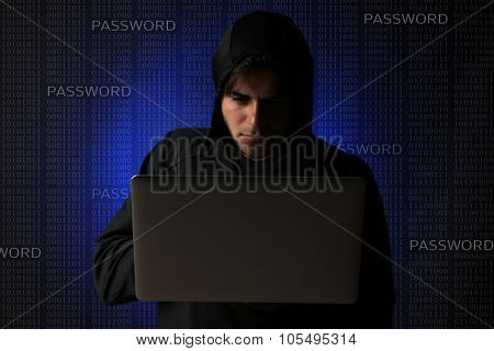 Hacker working with computer, binary code background
