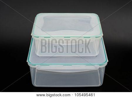 Translucent Storage Boxes Stack Up On A Black Background