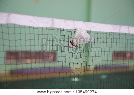 Shuttlecock Seized By The Net In A Badminton Courts