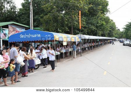 Udonthani Thailand - August 10: People Are Waiting For The Monks Walks Along A Street