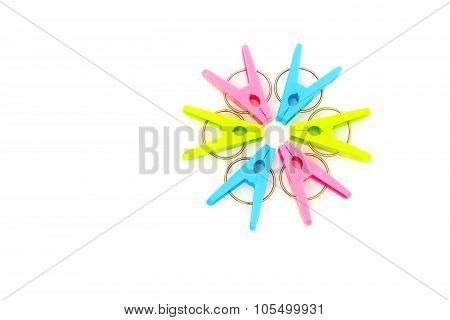 Colorful Clothespins Line Up As A Circle On A White Background