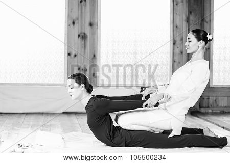 Woman getting thai stretching massage