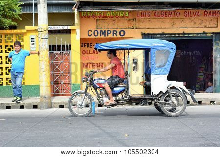 IQUITOS, PERU - OCTOBER 17, 2015: MotoKar on Iquitos street.  MotoKars are the most common form of street transportation in the Peruvian Amazon.