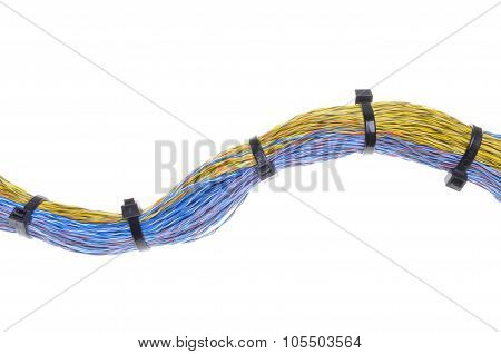 Multicolored cables with cable ties isolated on white background