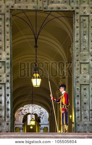 VATICAN CITY - SEPTEMBER 10: Unidentified Papal Swiss guard standing at the Vatican Museum door on September 10, 2015 in the Vatican. The Swiss guards served since the late 15th century.