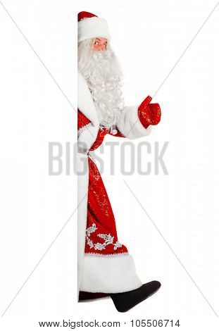 santa claus is walking out of white board, isolated on white