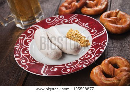 German white sausage or wurst served with mustard and pretzel