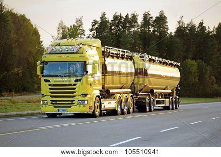 Yellow Scania R580 Tank Truck On The Road In Evening
