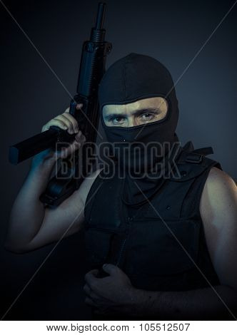 terrorist carrying a machine gun and balaclava