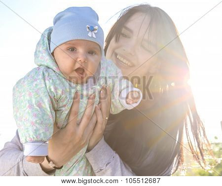 Mother and baby with backlight