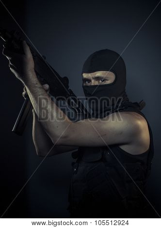 Outlaw, terrorist carrying a machine gun and balaclava