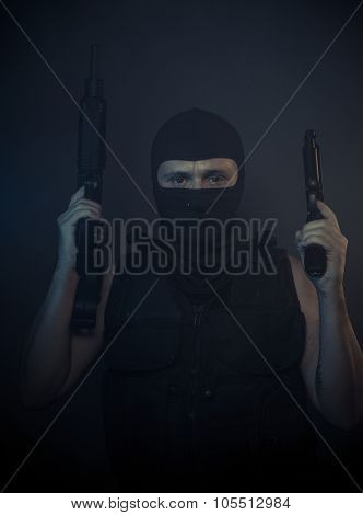 Aggression, terrorist carrying a machine gun and balaclava
