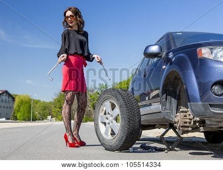 Nightlife dressed woman repairs car