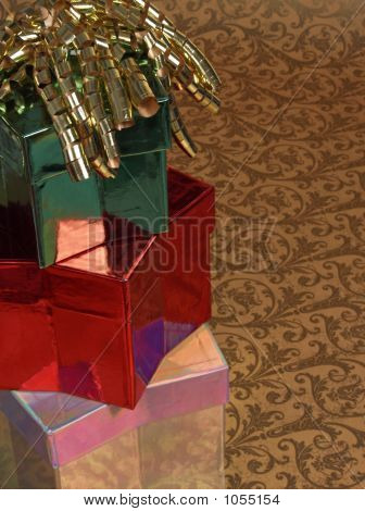 Three Stacked Gifts W/ Curly Ribbon