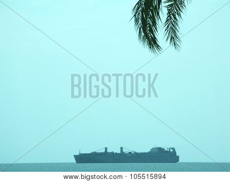 Cargo ship on the turquoise bay