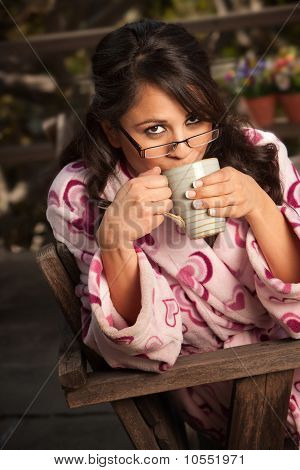 Pretty Hispanic Woman In Bathrobe With Tea Or Coffee