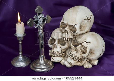 Crucifix and weathered human skull - Halloween background