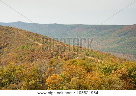 Talimena scenic byway with road running on the crest of the mountain, with fall colors
