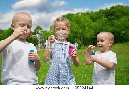 Brothers and sister are inflated bubbles in the summer park