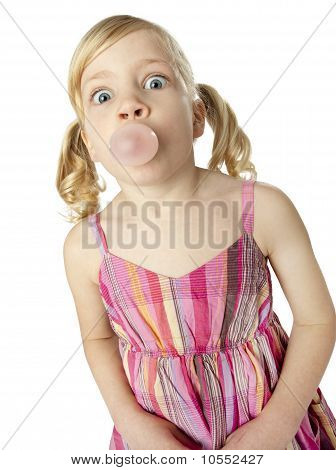 Young Girl Blowing Bubble With Gum