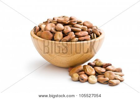 dried broad beans in wooden bowl on white background