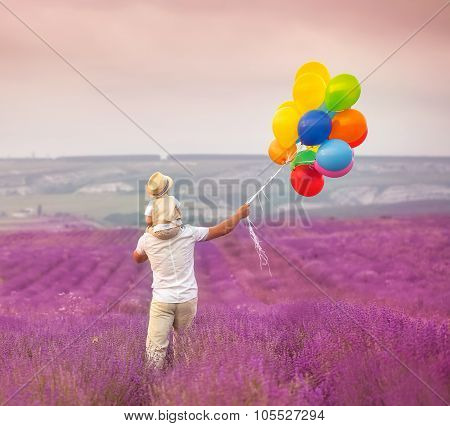 Father with son on lavender field