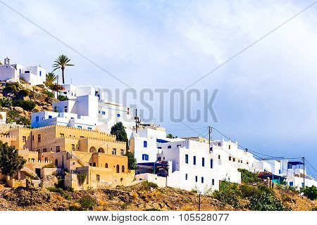 Typical white houses with blue shutters of Greek Island Ios