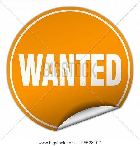 Wanted Round Orange Sticker Isolated On White